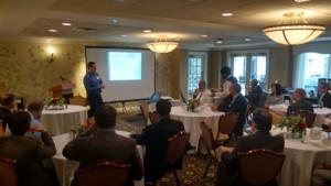 Travis speaking at CFMA meeting_041117